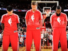Three players on the Red Rockets, scouring the court to make sure there's no dogshit.