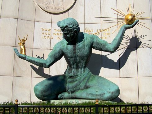 "The Iconic ""Spirit of Detroit"" monument.  In its left and right hands are Detroit mascots Ulrich the Urchin and ""The Naked Nicklesons"", respectively."