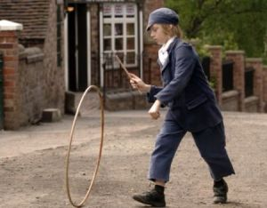 We're gonna end on a happy note.  Any white, male, protestant upper-class citizen could enjoy the awesomeness that was a hoop and stick.  Sure the ball and cup was cool, but NOTHING was cooler than pushing that big hollow circle through the cobblestoned streets with that flimsy little stick for hours and hours on end.  Weren't the 1790s just the best?  The answer is yes.  Yes they were.