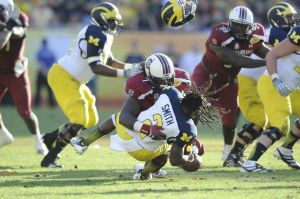 Jadeveon Clowney, consuming the life-force of Vincent Smith (via http://www.detroitlionsdraft.com/)