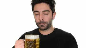 stock-footage-young-man-drinking-beer